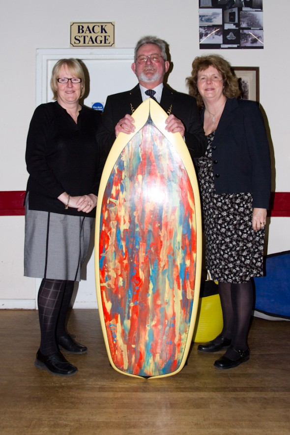 Cllr Gill Kennett, Cllr Clive Fleury and Sally Woods with Sid Pitman's JakeWilson surfboard